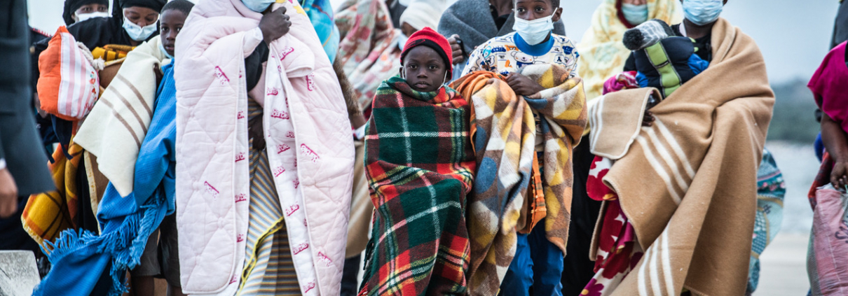 Rescued people with blankets in Olbia